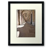 Commerce square arcades in Lisbon Framed Print