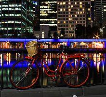 Red bike, blue river by Simon Penrose