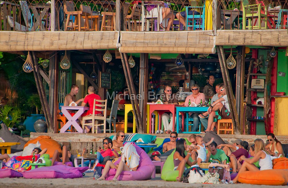 Colorful cafe at Seminyak Beach in Bali, Indonesia by Michael Brewer