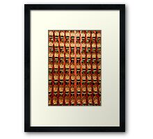 Wall of Buddhas at a Buddhist temple in Singapore Framed Print