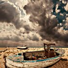 dreamy wrecked wooden fishing boats by meirionmatthias