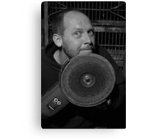 A mad man with a power tool Canvas Print