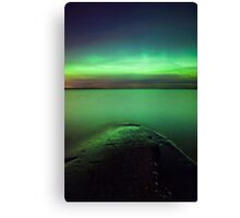 Northern lights glow over lake Canvas Print