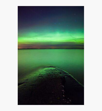 Northern lights glow over lake Photographic Print