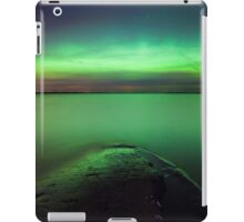Northern lights glow over lake iPad Case/Skin