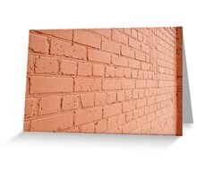 Angle view of a brick wall with a layer of red paint Greeting Card