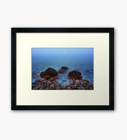 Sunset moon on the sea Framed Print