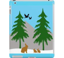 Winter scene with snow, bunnies, trees, and birds iPad Case/Skin