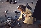 Girl feeding pigeons Trafalgar square 19570903 0006 by Fred Mitchell