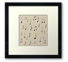 Musical notes on tan background Framed Print