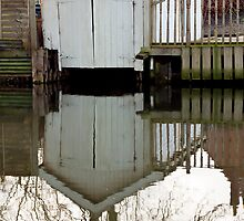 White boat-house reflection by Gary Rayner