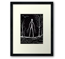 dark creepy slender man in forest on Halloween by Tia Knight Framed Print
