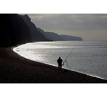 Fisherman angling on beach  Photographic Print