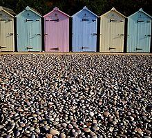 Colourful beach huts by nick pautrat