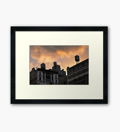 A buildings in New York City and old water towers.  Framed Print