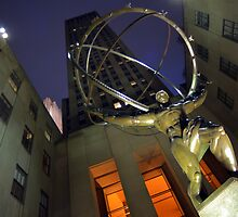 Atlas statue and Rockefeller center at dusk by Anton Oparin