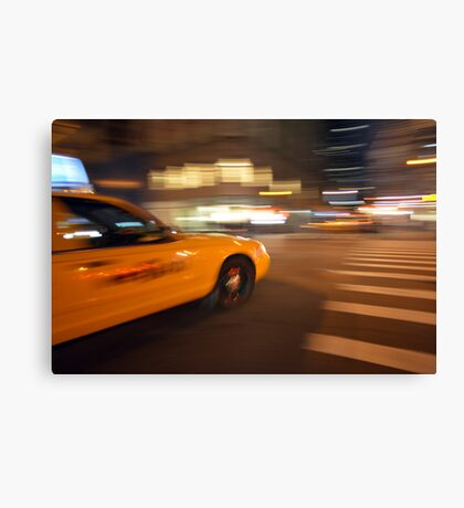 Blurred NYC taxi cab during the rush hour  Canvas Print