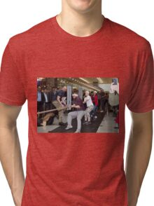 London Poppy day tug of war at Canary Wharf Docklands  Tri-blend T-Shirt