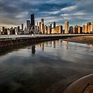 Chicago skyline at sunrise with a man for scale by Sven Brogren