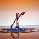 Water drops colliding to shape an umbrella splash by Sami Sarkis