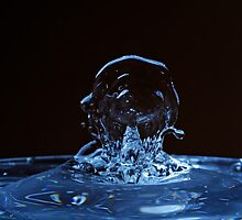 Splashing Water Droplet shaping human profile by Sami Sarkis
