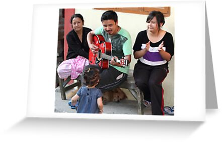 A musician entertaining his family. by debjyotinayak