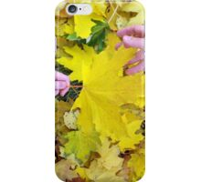 Hands of mother and daughter close-ups that hold the maple leaves iPhone Case/Skin