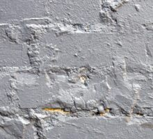 Fragment of a brick wall closeup with gray paint Sticker