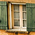 Green shutters on window in southern France by KSKphotography
