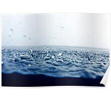 Rain drops falling into ocean Poster