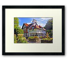 GUEST HOUSE Framed Print