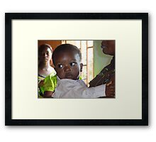 Bright eyes in Cameroon, Central Africa Framed Print
