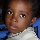 Bright eyes in Brazzaville, Republic du Congo by Baba John Goodwin