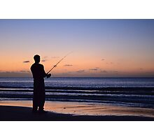 Fisherman on beach at sunset Photographic Print