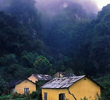 Vieng Xai misty cliffs. by Phil Bower