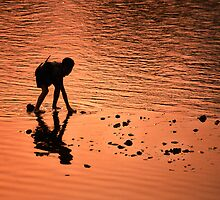 Sunset river boy. by Phil Bower