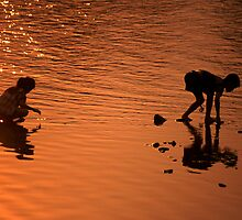 Sunset river kids. by Phil Bower