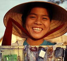 Smiling Vietnamese seller in Vientiane, Laos.  by Phil Bower
