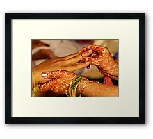 She Places the Ring Framed Print