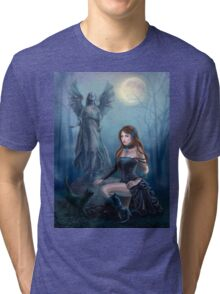 Fantasy beautiful woman with black cat about a statue. wood at night.  Tri-blend T-Shirt