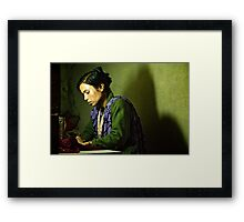 She Sews into the Night Framed Print