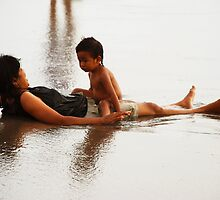 Mother and child at the beach by Michael Brewer