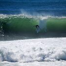 Occy dropping into a big shark island wave by Andrew  MCKENZIE