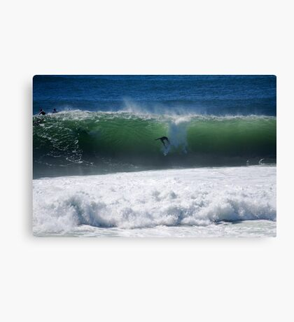 Occy dropping into a big shark island wave Canvas Print