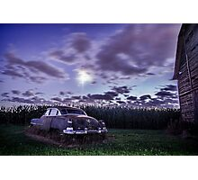 An old rusty 50's caddy in the moonlight by a cornfield Photographic Print