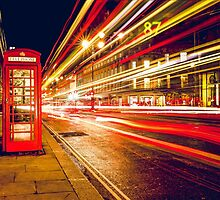 Vintage Red Telephone Box at Night in London by pdgraphics