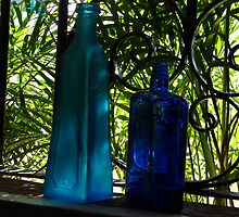 Blue Buddles in a Window with green Palms - Botellas Azules en una Ventana by PtoVallartaMex