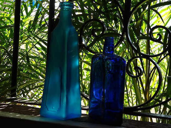 Blue Buddles in a Window with green Palms - Botellas Azules en una Ventana by PtoVallartaMex