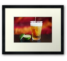 Beer being poured into glass with lime Framed Print