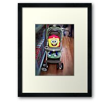 Character in a Stroller Framed Print